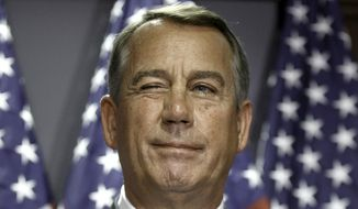 House Speaker John Boehner of Ohio gives a wink to a reporter as he answers questions with GOP leaders at Republican National Committee headquarters on Capitol Hill in Washington, Tuesday, July 15, 2014. (AP Photo/J. Scott Applewhite)