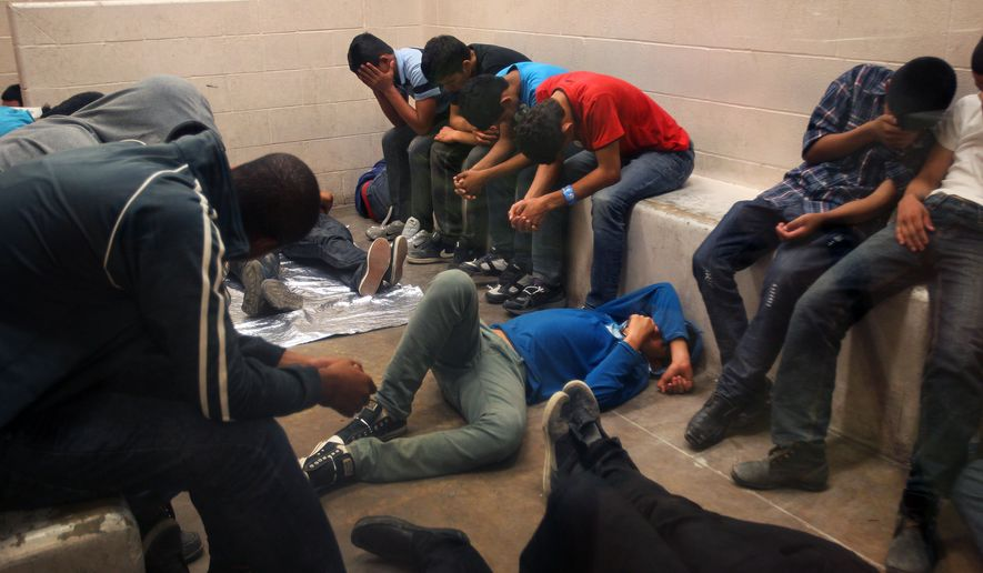 Immigrants who have been caught crossing the border illegally are housed inside the McAllen Border Patrol Station in McAllen, Texas where they are processed on Tuesday, July 15, 2014.  More than 57,000 unaccompanied children have been apprehended at the southwestern border since October, more than twice the total this time last year, many through the Rio Grande Valley. (AP Photo/Los Angeles Times,  Rick Loomis, Pool)