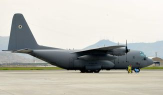 An Afghan Air Force C-130 sits on the flightline at Kabul Air Wing, Kabul International Airport, Kabul Afghanistan, on April 20, 2014.