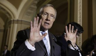 Senate Majority Leader Harry Reid of Nev., speaks to reporters on Capitol Hill in Washington, Tuesday, July 15, 2014, during a news conference about competing bills from the Democrats and Republicans on employee health coverage and birth control under the Affordable Care Act. (AP Photo/J. Scott Applewhite)