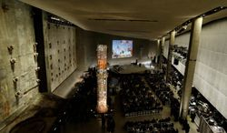 A video presentation at the opening ceremonies of the National 9/11 Memorial Museum in New York on May 15th of this year     Associated Press photo