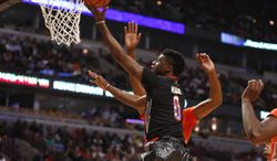 McDonald's West All-American Emmanuel Mudiay (0) shoots a layup during the first half of the McDonald's All-American boy's basketball game Wednesday, April 2, 2014, in Chicago.  (AP Photo/Charles Rex Arbogast)