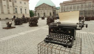 "**FILE** The ""Writer's Block"" in Berlin's Bebel Square marks on May, 10, 1999, the 60th anniversary of a mass-burning of books 66 years ago. Cages filled with typewriters from the twenties and thirties sit on the squares, where Nazis burnt books of foreign and German writers on May 10, 1933. The display by Sheryl Oring from Grand Forks, North Dakota is accompanied by a dance performance. (Associated Press)"