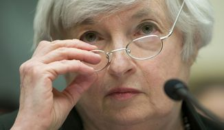 "Federal Reserve Chair Janet Yellen removes her glasses as she testifies on Capitol Hill in Washington, Wednesday, July 16, 2014, before the House Financial Services Committee hearing entitled: ""Monetary Policy and the State of the Economy.  (AP Photo/Pablo Martinez Monsivais)"
