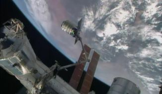 In this image from NASA-TV shows the Cygnus cargo spacecraft after it was grappled by the International Space Station's Canadarm Wednesday July 16, 2014 as the pair flew over Kenya. The Cygnus spacecraft is filled with over 3,000 pounds of supplies for the International Space Station in the company's second contracted cargo delivery flight to the space station for NASA. (AP Photo/NASA-TV)