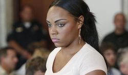 """FILE - In this July 24, 2013, file photo, Shayanna Jenkins, fiancee of former New England Patriots NFL football player Aaron Hernandez, arrives at hearing for Hernandez at Attleboro District Courtroom in Attleboro, Mass. Prosecutors said in a filing Wednesday, July 16, 2014, that they have """"direct evidence"""" that Jenkins lied to the grand jury that indicted Hernandez on a murder charge in the slaying of Odin Lloyd, including about a box she discarded at Hernandez's direction. (AP Photo/Bizuayehu Tesfaye, File)"""