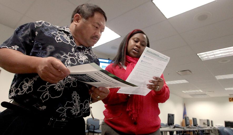 FILE - In this Oct. 1, 2013 file photo Chongtou Yang, 59, of Cottage Grove, Wis., gets  guidance on the health insurance exchanges from counselor Lorraine McGowan at the Dane County Job Center in Madison, Wis. Figures released Wednesday, July 16, 2014 by Wisconsin Gov. Scott Walker's administration show that more than 60 percent of the people who lost state Medicaid coverage earlier this year did not purchase private insurance through the online marketplace. (AP Photo/Wisconsin State Journal, John Hart, File)