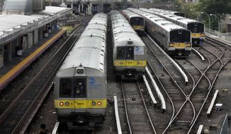 Long Island Rail Road trains queue for deployment at Jamaica station, in the Queens borough of New York, Wednesday, July 16, 2014. Negotiations aimed at avoiding a walkout at the nation's largest commuter railroad resumed Wednesday after Gov. Andrew Cuomo prodded both sides to find an agreement that would keep 300,000 daily riders from being forced to find alternate ways of getting in and out of New York City. (AP Photo/Richard Drew)