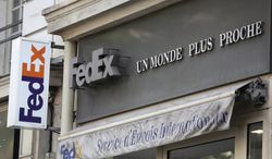 ** FILE ** The Fedex delivery company logo at the office of the Haussmann boulevard in Paris, Wednesday July 16, 2014. (AP Photo/Remy de la Mauviniere)