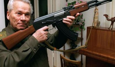 ** FILE **  Mikhail Kalashnikov shows a model of his world-famous AK-47 assault rifle at home in the Ural Mountain city of Izhevsk in 1997.  (Associated Press)