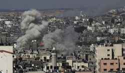 Smoke rises after Israeli missile strikes hit the northern Gaza Strip, Wednesday, July 16, 2014. Israeli war planes and naval vessels intensified attacks across the Gaza Strip on Wednesday, targeting senior Hamas leaders and bombarding a coastal area, where four Palestinian boys were killed. (AP Photo/Adel Hana)