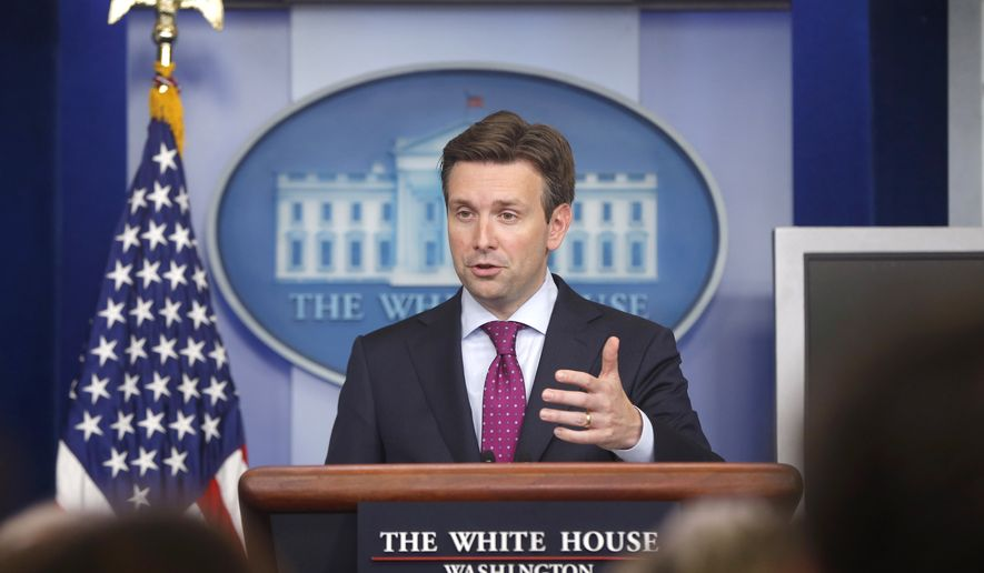 White House press secretary Josh Earnest answers questions from reporters during the daily press briefing at the White House in Washington, Wednesday, July 16, 2014. Earnest took questions on the Middle East, Iran, Ukraine, and immigration. (AP Photo/Charles Dharapak)