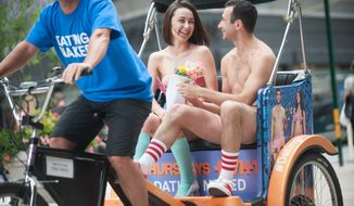 "IMAGE DISTRIBUTED FOR VH1 - Couples take a ride in a pedicab to promote the new VH1 series ""Dating Naked"" on Wednesday, July 16, 2014, in New York City. (Photo by Scott Gries/Invision for VH1/AP Images)"