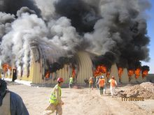 A fire at an arch-span building at Afghan National Army Brigade Camp Sayar is seen here on Oct. 17, 2012. The fire incident report noted the building was 85 percent completed and burned in 30 minutes. (U.S. Army Corps of Engineers)