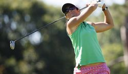 Laura Diaz tees off on the seventh hole during the the first round of the Marathon Classic LPGA golf tournament at Highland Meadows Golf Club in Sylvania, Ohio, Thursday, July 17, 2014. (AP Photo/Rick Osentoski)