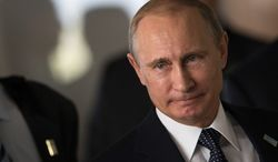Russian President Vladimir Putin informed President Obama of the downing of a Malaysia Airlines passenger jet near the end of a telephone call about U.S. sanctions. (Associated Press)