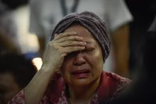 Kuala Lumpur International Airport was filled with disbelief after news about the loss of another Malaysia Airlines jet. (Associated Press)
