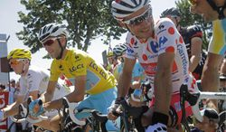 France's Romain Bardet, wearing the best young rider's white jersey, Italy's Vincenzo Nibali, wearing the overall leader's yellow jersey, and Spain's Joaquim Rodriguez, wearing the best climber's dotted jersey, wait for the start of the twelfth stage of the Tour de France cycling race over 185.5 kilometers (115.3 miles) with start in Bourg-en-Bresse and finish in Saint-Etienne, France, Thursday, July 17, 2014. (AP Photo/Laurent Cipriani)