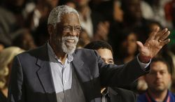Former NBA player Bill Russell waves to the crowd during the NBA All Star basketball game, Sunday, Feb. 16, 2014, in New Orleans. (AP Photo/Gerald Herbert)