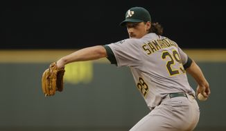Oakland Athletics starting pitcher Jeff Samardzija throws against the Seattle Mariners during a baseball game, Friday, July 11, 2014, in Seattle. (AP Photo/Ted S. Warren)