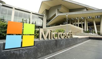 CORRECTS TO SAY THAT MICROSOFT WILL ELIMINATE UP TO 18,000 INSTEAD OF 18,000 - This July 3, 2014 photo shows Microsoft Corp. signage outside the Microsoft Visitor Center in Redmond, Wash. Microsoft on Thursday, July 17, 2014 announced it will lay off up to 18,000 workers over the next year. (AP Photo Ted S. Warren)