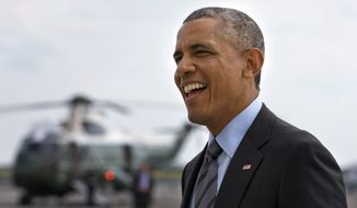 President Barack Obama smiles at a group of people welcoming him as he arrives in New York where he will attend fundraisers Thursday, July 17, 2014. (AP Photo/Jacquelyn Martin)