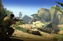 A player helps American OSS officer, Karl Fairburne survive against the Nazis in desert terrain in the World War II, third person shooter Sniper Elite III.