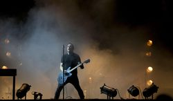 FILE - In this March 27, 2014 file photo, Trent Reznor of Nine Inch Nails performs at the Vive Latino music festival in Mexico City, Mexico. Reznor and his band, Nine Inch Nails, embark on a North America tour co-headlining with Soundgarden, on Saturday, July 19, 2014, in Las Vegas.  (AP Photo/Rebecca Blackwell, file)