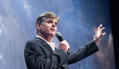 """Political commentator Sean Hannity addresses the crowd while delivering his speech, """"Get America Back to Work"""", Thursday, May 22, 2014, during the 22nd Williston Basin Petroleum Conference held in Bismarck, N.D. (AP Photo/Kevin Cederstrom)"""