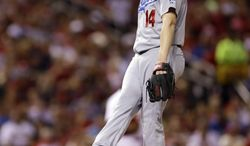 Los Angeles Dodgers starting pitcher Dan Haren kicks at the mound as he waits to be removed from a baseball game against the St. Louis Cardinals during the fifth inning Friday, July 18, 2014, in St. Louis. (AP Photo/Jeff Roberson)