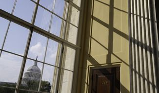 **FILE** The Capitol is seen from the Cannon House Office Building in Washington on June 9, 2014. (Associated Press)