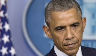 President Obama pauses while speaking about the situation in Ukraine in the Brady Press Briefing Room of the White House on July 18, 2014. Obama called for immediate ceasefire in Ukraine, demands credible investigation of downed plane. (Associated Press)