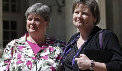 File - In the April 17, 2014, photo plaintiffs challenging Oklahoma's gay marriage ban Sharon Baldwin, left, and her partner Mary Bishop leave court following a hearing at the 10th U.S. Circuit Court of Appeals in Denver, Thursday, April 17, 2014. The three-judge panel of the 10th U.S. Circuit Court of Appeals in Denver on Friday, July 18, 2014, found a ban on same-sex marriage in Oklahoma violates the U.S. Constitution. In a Utah case, the court ruled June 25 that gay couples have a constitutional right to wed. (AP Photo/Brennan Linsley, File)