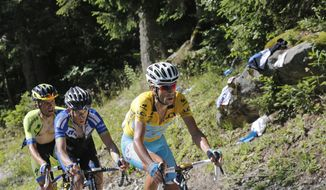 Stage winner Italy's Vincenzo Nibali, wearing the overall leader's yellow jersey, Leopold Konig of the Czech Republic, center, and Poland Rafal Majka, left, climb towards Chamrousse during the thirteenth stage of the Tour de France cycling race over 197.5 kilometers (122.7 miles) with start in Saint-Etienne and finish in Chamrousse, France, Friday, July 18, 2014. (AP Photo/Christophe Ena)