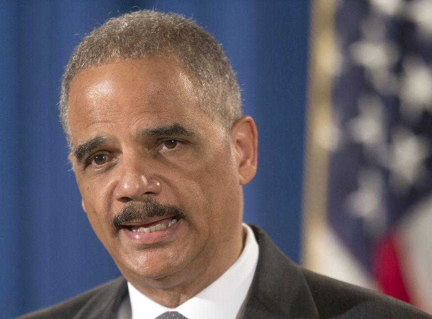 **FILE** Attorney General Eric Holder speaks July 14, 2014, at the Justice Department building in Washington. (Associated Press)
