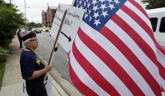** FILE ** Protesters gather outside the Mexican Consulate, Friday, July 18, 2014, in Austin, Texas. (AP Photo/Eric Gay)