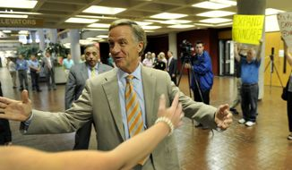 ** FILE ** Gov. Bill Haslam greets friends before casting his ballot on the first day of early voting Friday, July 18, 2014, in Knoxville, Tenn. The State Primary and County General Election is Aug. 7. (AP Photo/Michael Patrick, Knoxville News Sentinel)
