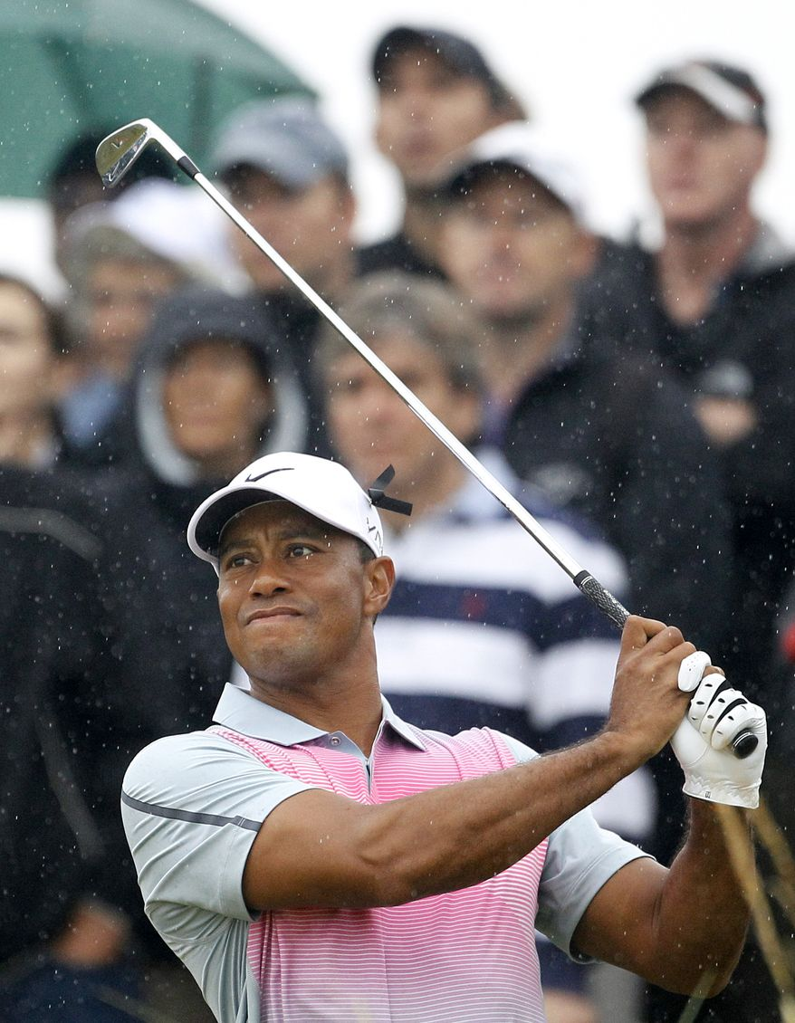 Tiger Woods of the US plays his tee shot from the 14th during the third day of the British Open Golf championship at the Royal Liverpool golf club, Hoylake, England, Saturday July 19, 2014. (AP Photo/Peter Morrison)