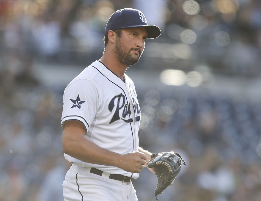 San Diego Padres closer Huston Street pumps his fist as he watches the game ending double play in the Padres' 4-1 victory over the Seattle Mariners in a baseball game Thursday, June 19, 2014, in San Diego. Street converted his 20th save without a blown save.  (AP Photo/Lenny Ignelzi)