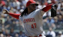 Cincinnati Reds starting pitcher Johnny Cueto throws during the second inning of the game against the New York Yankees at Yankee Stadium Sunday, July 20, 2014 in New York. (AP Photo/Seth Wenig)