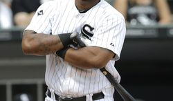 Chicago White Sox's Dayan Viciedo reacts after being called out on strikes during the third inning of a baseball game against the Houston Astros in Chicago on Sunday, July 20, 2014. (AP Photo/Nam Y. Huh)