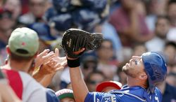 Kansas City Royals' Brett Hayes makes the catch on a pop foul by Boston Red Sox's David Ross during the fifth inning of a baseball game in Boston, Sunday, July 20, 2014. (AP Photo/Michael Dwyer)