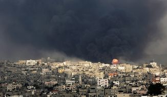 Smoke and fire of an explosion after an Israeli missile hits the Shijaiyah neighborhood in Gaza City.