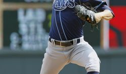 Tampa Bay Rays starting pitcher Chris Archer throws against the Minnesota Twins during the third inning of a baseball game in Minneapolis, Sunday, July 20, 2014. (AP Photo/Ann Heisenfelt)