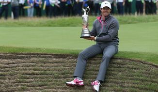 Rory McIlroy of Northern Ireland holds the Claret Jug trophy after winning the British Open Golf championship at the Royal Liverpool golf club, Hoylake, England, Sunday July 20, 2014.  (AP Photo/Scott Heppell)