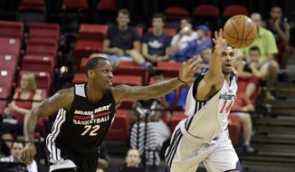 Miami Heat's James Nunnally (72) and Washington Wizzards' Glen Rice Jr. (14) go after a loose ball during the first half of an NBA summer league basketball game Tuesday, July 15, 2014, in Las Vegas. (AP Photo/Isaac Brekken)