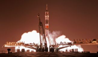 The Soyuz-FG rocket booster with Soyuz TMA-13M space ship carrying a new crew to the International Space Station, ISS, blasts off at the Russian leased Baikonur cosmodrome, Kazakhstan.  (AP Photo/Dmitry Lovetsky)