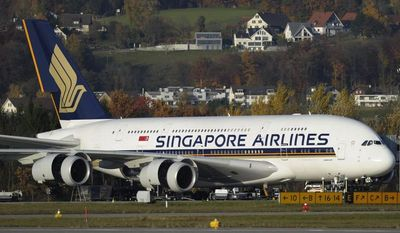 A Singapore Airlines Airbus A-380 has its engine checked, at the Airport Zuerich, in Switzerland, in this Nov. 4, 2010, file photo. Tests uncovered oil stains in three Rolls-Royce engines on Singapore Airlines' A380 superjumbos, prompting the airline to yank the planes from service Wednesday Nov. 10, 2010 just two days after Qantas announced troubling oil leaks on their A380s. (AP Photo/Keystone, Steffen Schmidt, File)
