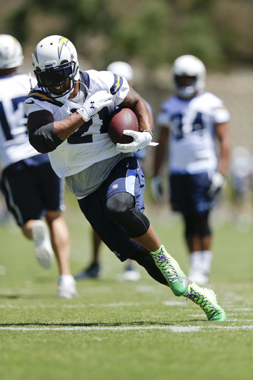 FILE - In this June 17, 2014 file photo, San Diego Chargers running back Ryan Mathews heads upfield during NFL football minicamp at the team's facility in San Diego. This could be a pivotal year for running back Mathews, who enters the final season of a five-year contract he signed after the Chargers drafted him in the first round to replace LaDainian Tomlinson. (AP Photo/Gregory Bull, File)