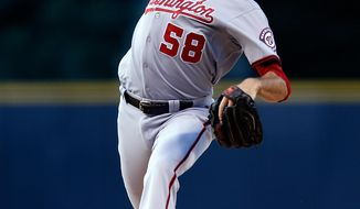 Washington Nationals starting pitcher Doug Fister throws to the plate against the Colorado Rockies during the first inning of a baseball game on Monday, July 21, 2014, in Denver. (AP Photo/Jack Dempsey)